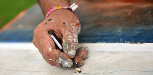 Painter hand with pencil